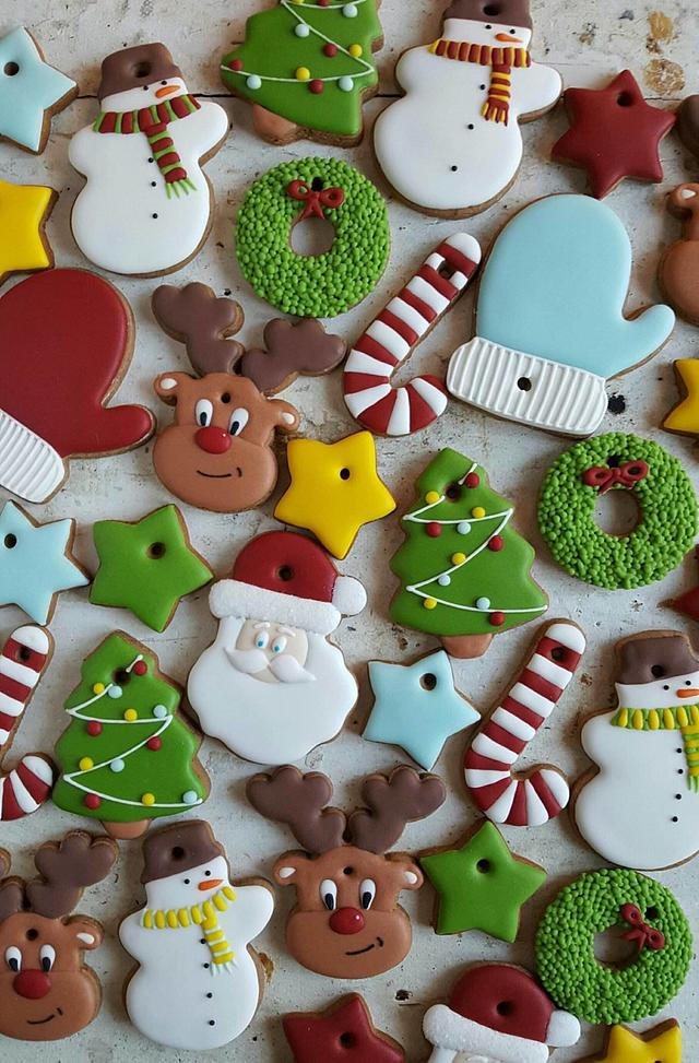 A spread of pretty reindeer, knittens, wreath shaped cookies decorated with royal icing