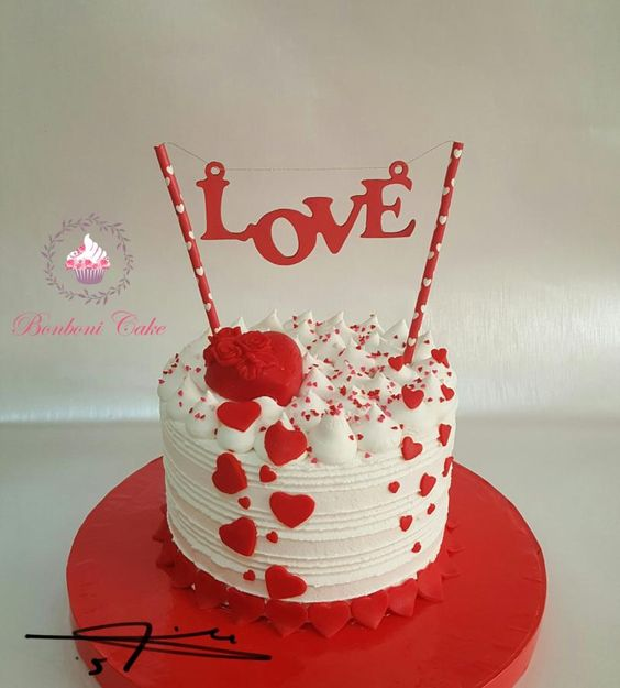 Cream cake with red fondant hearts and LOVE written on it