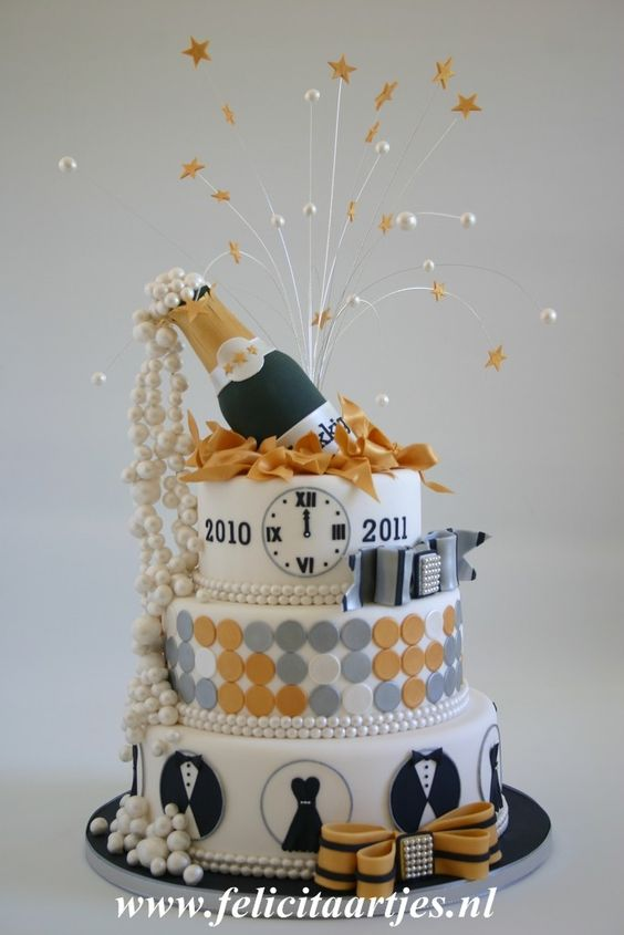 a fun new years theme 3 tier cake topped with a fondant champagne bottle and stars over it