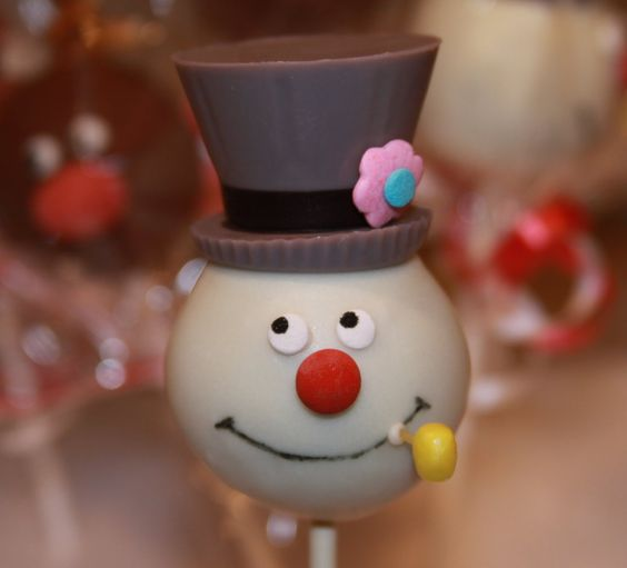 a cake pop made to look like a man with a brown hat