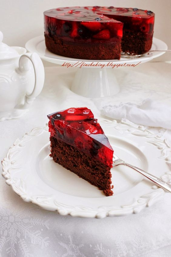 A chocolate cake on the base and then topped with a layer of jelly filled with berries