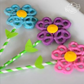 pretzels dipped in colored chocolates and stuck together to make it look like a flower