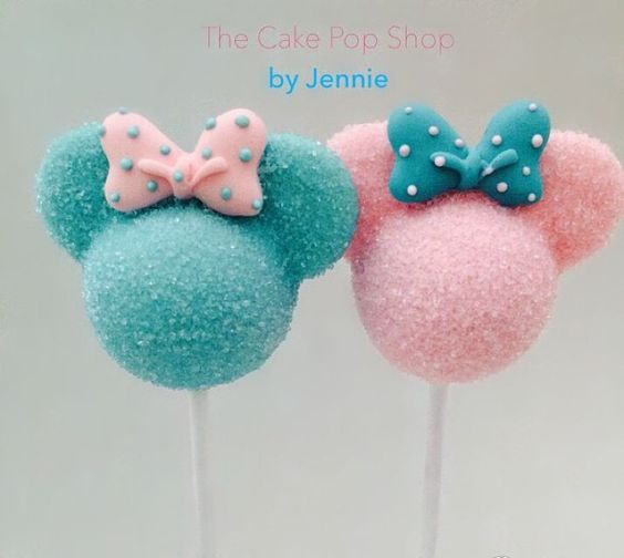 a mickey themed cakepop made in pink and blue with colored sugar on it