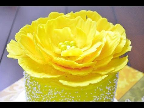 yellow flower petals made of candy melts and yellow sugar beads in the center