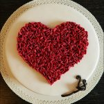 full heart cake covered with ruffles all around with red fondant