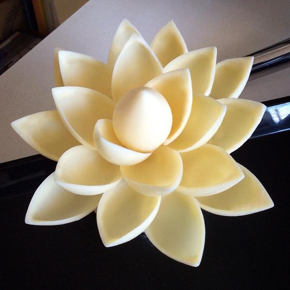 white color flower with with candy, made using a plastic spoon
