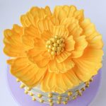 a bright yellow peony made with candy melts