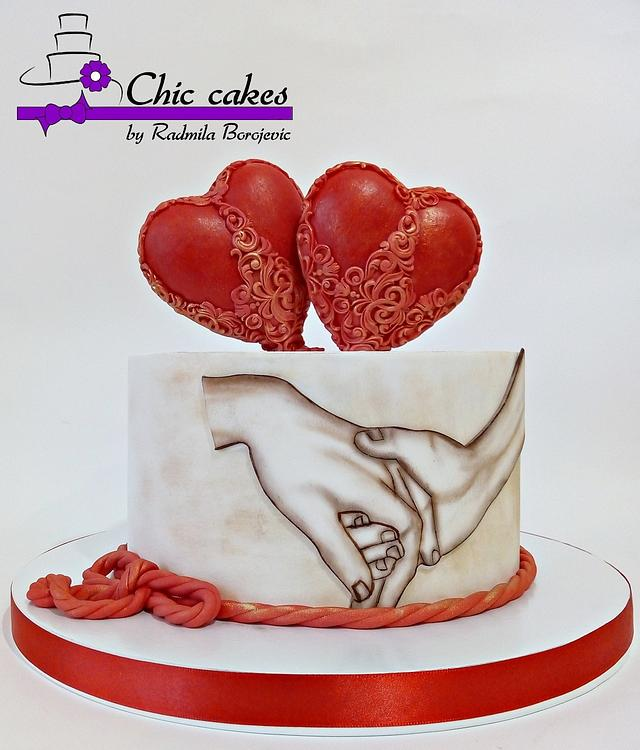 Hand painted cake with 2 fondant hearts on it