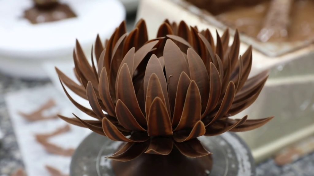A brown chocolate flower with long leaves