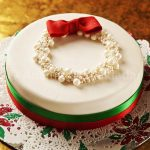 An easy and quick cake with a box and pearls topped on the cake