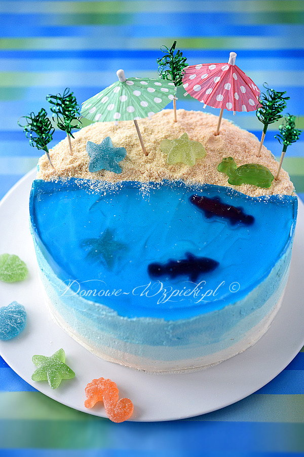 a beach theme cake with blue jelly on the outside
