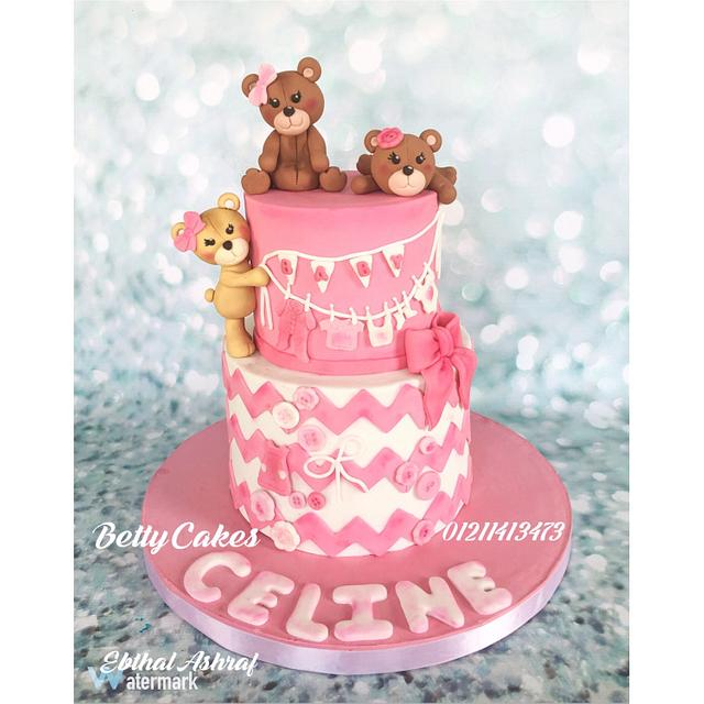 two tier pink and white baby shower cake with fondant teddy bears