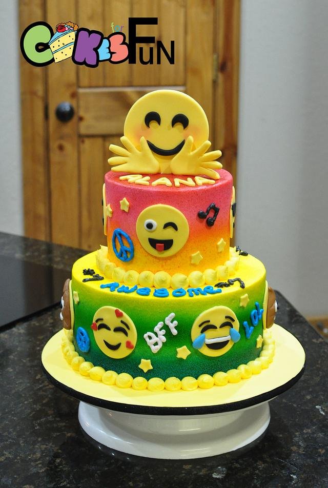 3 tier fun colorful cake with fondant emojis pasted on each tier