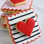 black and white cookie with red heart cookie on it - Valentines Day Cookies Tutorials