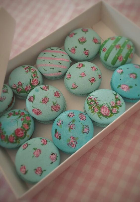 floral macarons in shades of green and blue