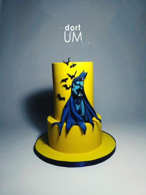 a yellow two tier cake and blue color batman on it - Superhero Cake Tutorials