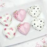 heart shaped chocolate hearts shells painted in black and white polka dots and pink flowers on white heart shell - Valentines Day Fun Tutorials