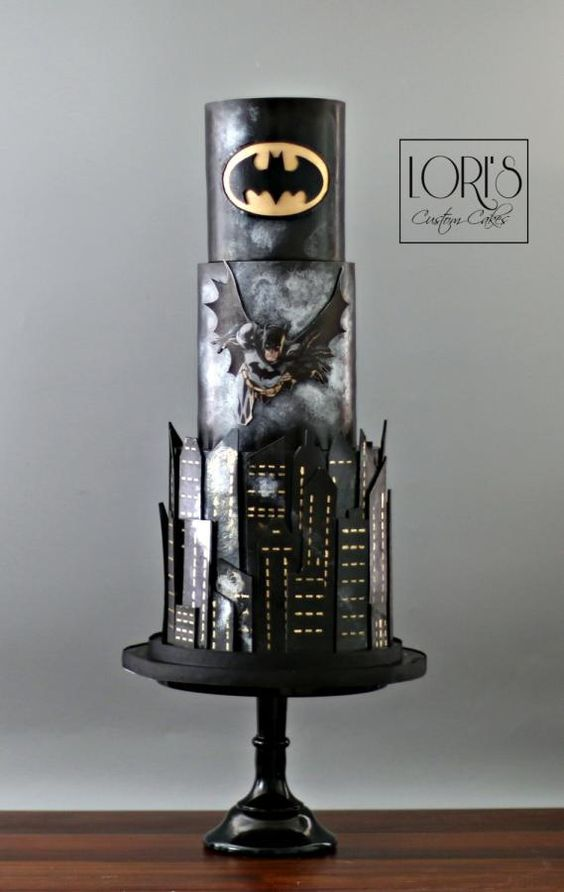 3 tier black cake, batman style with wings and logo