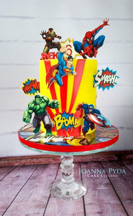 yellow and red theme cake with all superhero characters made with edible printed characters on it