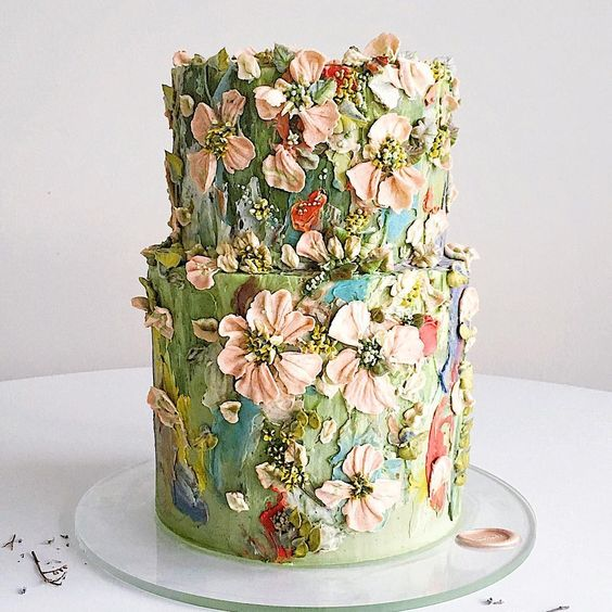 Buttercream Flower painting tutorials - two tier green cake with butter cream frosting and knives