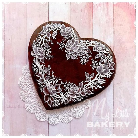 brown cookie base with white royal icing embroidery work on it - Valentines Day Cookies Tutorials