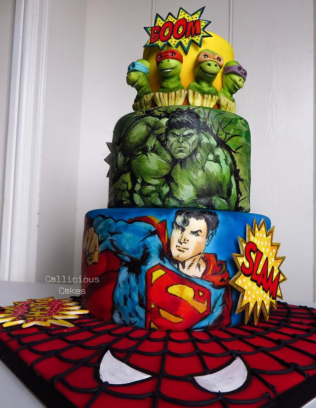 painted superman on the cake with hulk painted on the middle tier - Superhero Cake Tutorials
