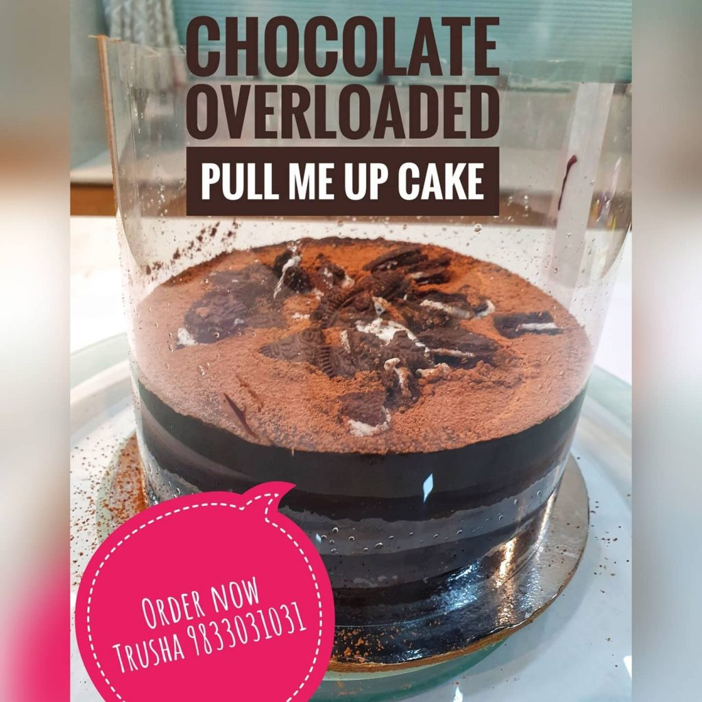 a chocolate cake with oreo biscuits on a pull me up cake