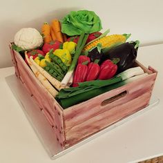 a box full of fondant wood effect and sugar vegetables on it - Vegetable Theme Cake Tutorials