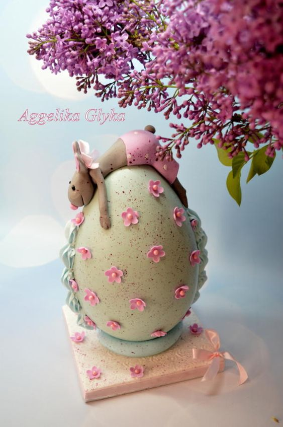 green theme chocolate shell with bunny rabbit of sugar on it and pink flowers