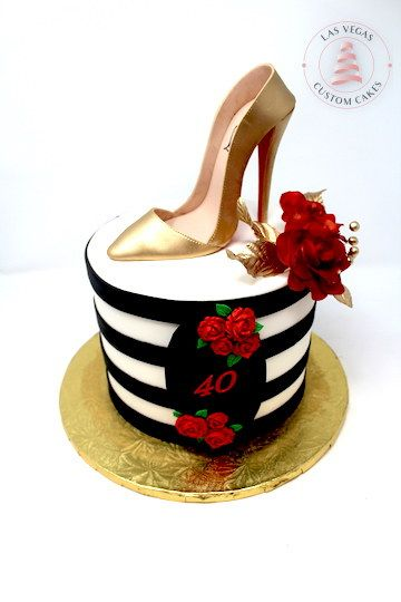black stripes on a white cake with a golden slipper
