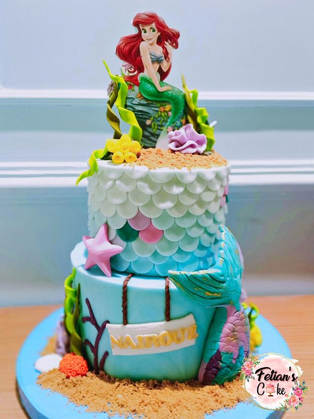 a sea theme cake for a beach part on the beach with ombre effect and fondant work