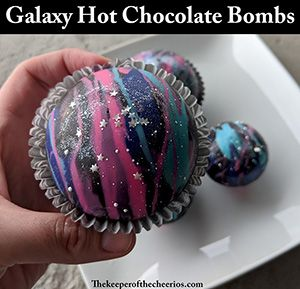 galaxy theme colored effect on a ball made of colored chocolates and filled with marshmallows