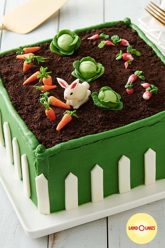 green cake with mud effect and fondant rabbit with veggies