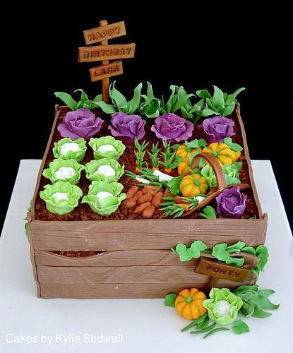Vegetable Theme Cake Tutorials - a wooden box effect cake with growing vegetables made of sugar on it