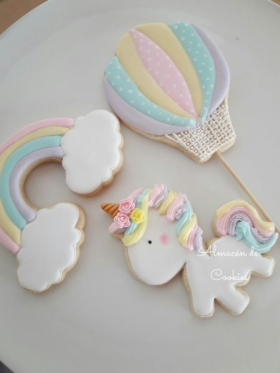 a parachute cookie with rainbow cloud cookie and a white unicorn