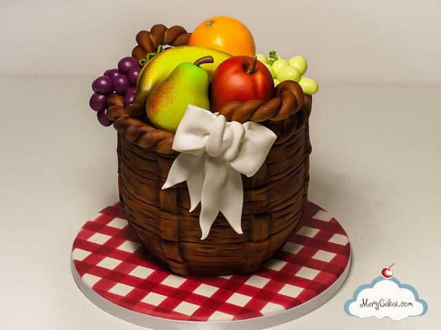 a basket of fruits made using cakes and sugar paste