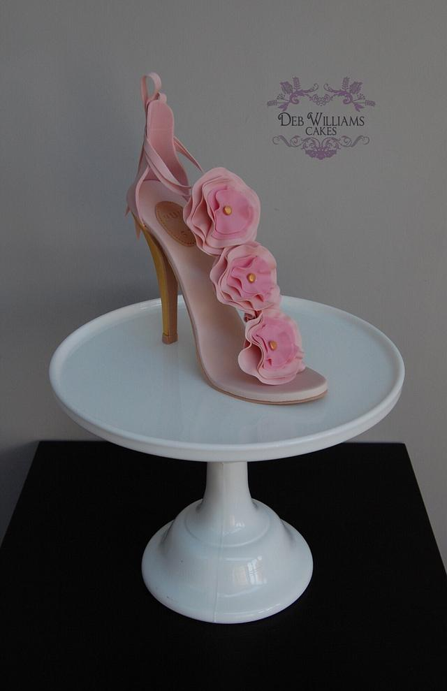 a pink sugar sandal cake for ladies, made out of sugar