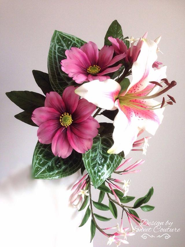a branch pf cosmos flowers in purple , sugar lily and leaves