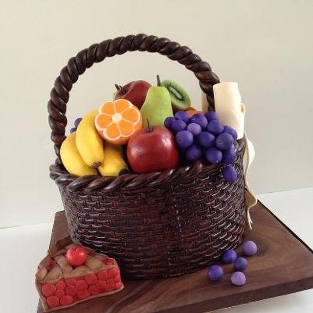a cake basket with fruits in it made of fondant - Fruit Carving Cake Tutorials