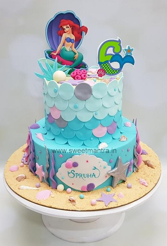an ombre efffect blue cake with sea shells and star fish