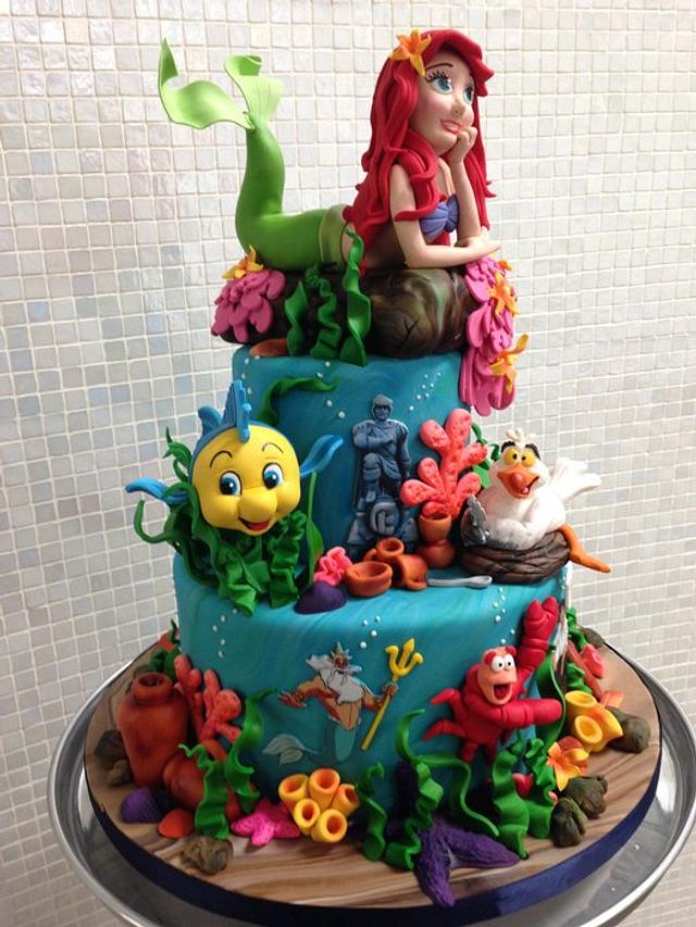 a sea theme cake with fishes, sea weed and crabs. colorful aqua theme cake
