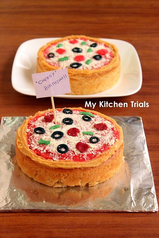 brown bread made on edible sponge topped with fondant pepperoni and olives
