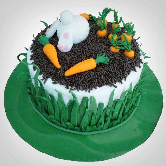fondant carrots and bunny on a cake with chocolate sprinkles for mud effect - Easter Cake Tutorials