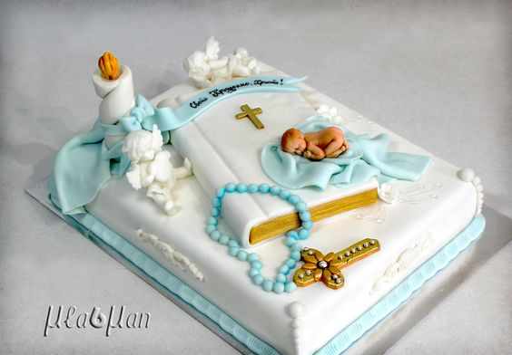 bible theme cake with an edible fondant baby and sugar candle, rosary, angels