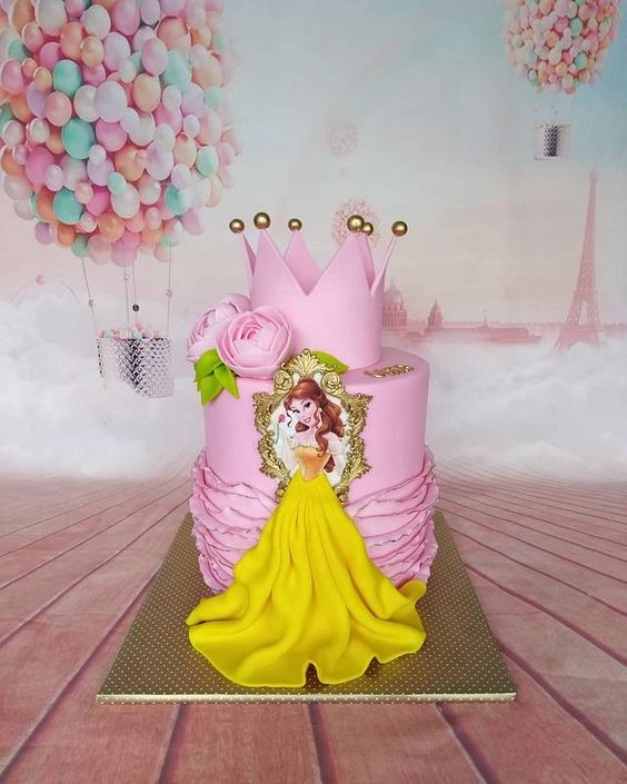 a pink ruffle effect cake with a princess in a yellow gown made of fondant