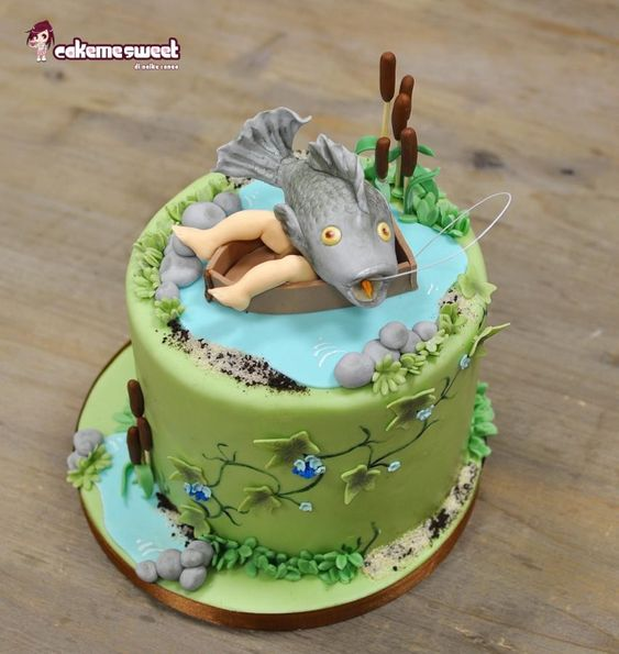 a fish with a sugar figurine legs and green fondant covered cake