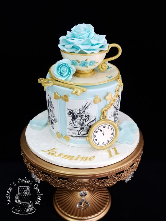 blue sugar rose with gold sugar key and clock made of fondant