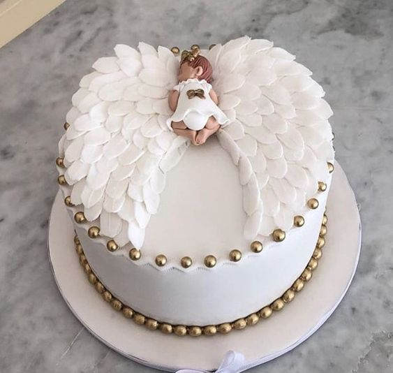 white fondant wings made of sugar with a fondant baby figurine