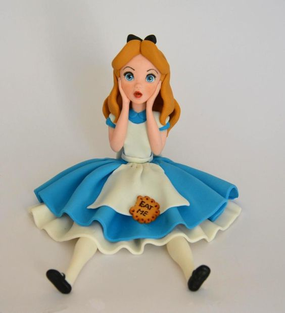 Alice character sugar figurine with a blue and white dress