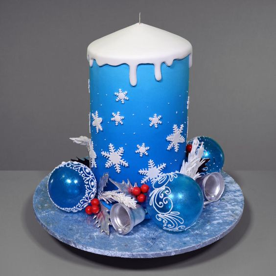 blue snowflakes made on sugar on fondant airbrushed cake